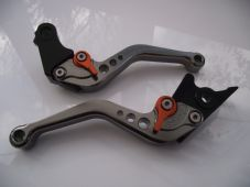 KTM (640, 625, 660,) CNC levers set short titanium & orange adjusters DB12/C31